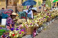 Antigua, Guatemala.  Palm Sunday outside La Merced Church.  Vendors of Palm Fronds and Flowers.