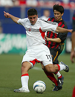 17 April 2004: DC United Alecko Eskandarian kicks the ball away from MetroStars Joselito Vaca at Giants' Stadium in East Rutherford, New Jersey.  MetroStars defeated DC United, 3-2.