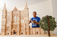 Match made in heaven? Model-maker strikes millionth match in his bid to break a world record.
