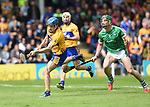 Shane O'Donnell of Clare scores his second goal  despite Sean Finn of Limerick during their Munster Championship semi-final at Thurles.  Photograph by John Kelly.