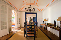 Private home in Parati Brazil. View of the dinning room with colonial chairs and table.