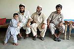 """Brother (from left to right) Sirajullah (36) with son Hishirs(6) , Abdul Jabar and Israrullah Shah(42) at Nawagai village in the troubled Buner District of Pakistan's North West Frontier Province. Abdul and Sirajullah have just returned to their home after spending 60 days at the Chota Lahore refugee camp in dire conditions. Israrullah stayed behind during the fighting between the army and Taliban to ensure the safety of their homes and possessions surviving bullets and air strikes. By a quirk of fate another brother ,Imranullah ,  was working for an NGO at the refugee camp at the same time. Coming back to their homes was like """"Eid"""" according to the brothers who number six in total.  The Pakistani army claims to have driven the Taliban from the area and many people are leaving the refugee camps in Swabi and heading home. Reports of continuing Taliban presence in the area continue to surface however and it is clear the area is still far from safe and secure."""