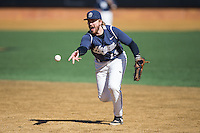 AC Carter (13) of the Georgetown Hoyas flips the ball towards first base during the game against the VCU Rams at Wake Forest Baseball Park on February 13, 2015 in Winston-Salem, North Carolina.  The Rams defeated the Hoyas 6-3.  (Brian Westerholt/Four Seam Images)
