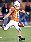 Texas Longhorns kicker Justin Tucker (19) punts the ball during the game between the Oklahoma State Cowboys and the University of Texas in Austin Texas Longhorns at the Daryl K. Royal- Texas Memorial Stadium in Austin, Texas. The Oklahoma State Cowboys defeated the Texas Longhorns 33 to 16.