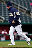 Coach Rob Walton (10) walks back to the dugout after switching pitchers during a game against the Missouri State Bears on March 27, 2011 at Hammons Field in Springfield, Missouri.  Photo By David Welker/Four Seam Images