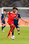 Raed Saleh of Oman (L) runs with the ball as he is followed by Minamino Takumi of Japan (R) during the AFC Asian Cup UAE 2019 Group F match between Oman (OMA) and Japan (JPN) at Zayed Sports City Stadium on 13 January 2019 in Abu Dhabi, United Arab Emirates. Photo by Marcio Rodrigo Machado / Power Sport Images