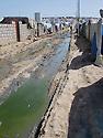 Iraq 2013 .Domiz Refugee Camp, after the rain, muddy lane.Irak 2013.Dans le camp de Domiz, apres la pluie, chemin boueux