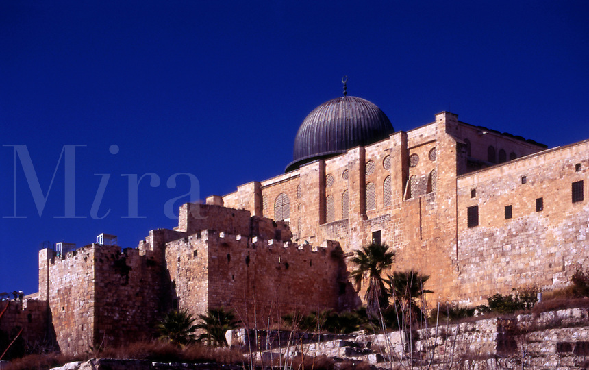 The southern wall of the Temple Mount and of the Old City of Jerusalem (Israel).  The Al Aqsa mosque rises above the wall.   Below are ruins from the time of the 2nd temple, approximately the year 0.