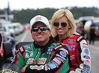 Mar. 9, 2012; Gainesville, FL, USA; NHRA funny car driver John Force (left) with daughter Courtney Force during qualifying for the Gatornationals at Auto Plus Raceway at Gainesville. Mandatory Credit: Mark J. Rebilas-