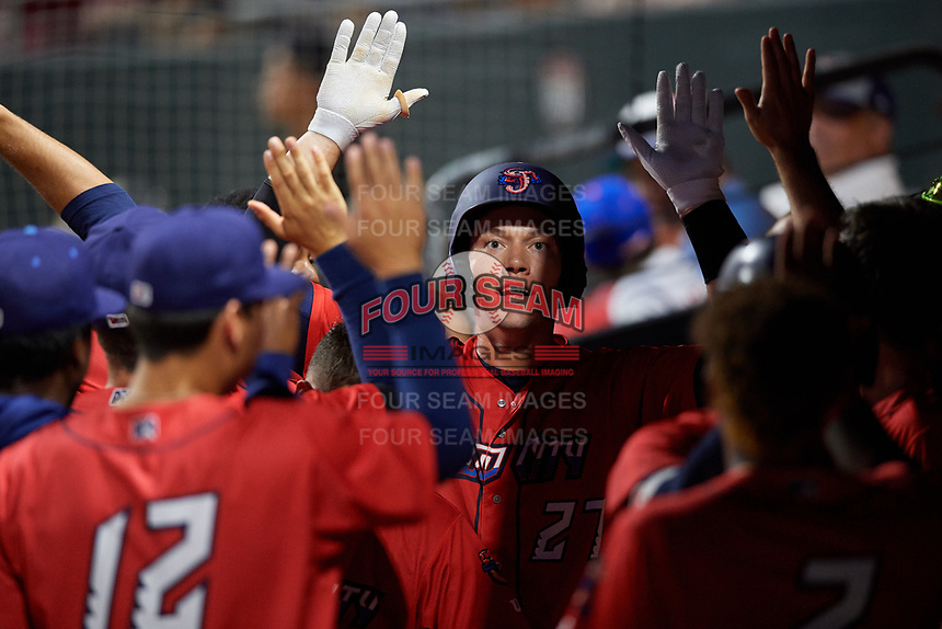 Jacksonville Jumbo Shrimp left fielder Peter O'Brien (27) high fives with his teammates in the dugout after hitting a home run in the bottom of the fourth inning during a game against the Biloxi Shuckers on June 8, 2018 at Baseball Grounds of Jacksonville in Jacksonville, Florida.  Biloxi defeated Jacksonville 5-3.  (Mike Janes/Four Seam Images)