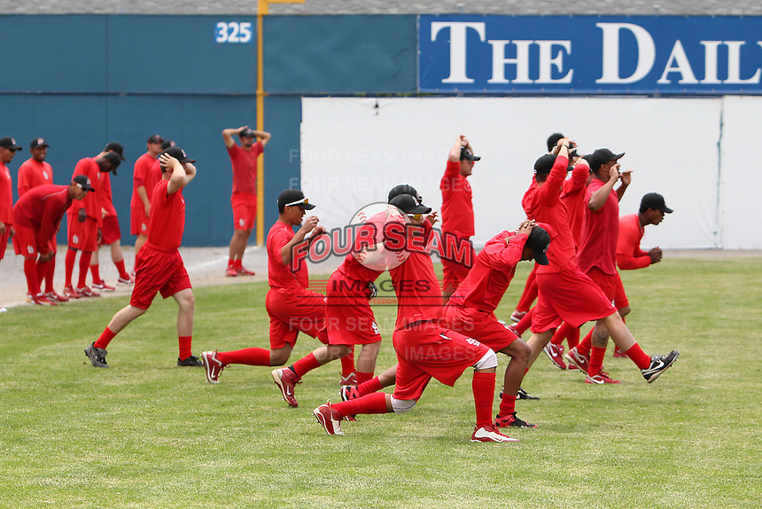 Batavia Muckdogs players stretch during the first day of practice for the start of the NY-Penn League season at the Dwyer Stadium in Batavia, New York;  June 13, 2011.  Photo By Mike Janes/Four Seam Images