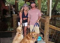 Emily and Brock Boyd, with Daisy (left) and Duke, attend Dog Days of Summer.<br /> (NWA Democrat-Gazette/Carin Schoppmeyer)