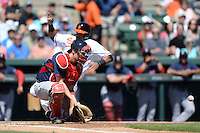 Boston Red Sox catcher Ryan Lavarnway (20) fields a throw as Nelson Cruz slides into home during a spring training game against the Baltimore Orioles on March 8, 2014 at Ed Smith Stadium in Sarasota, Florida.  Baltimore defeated Boston 7-3.  (Mike Janes/Four Seam Images)