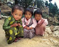 Tibetans, Dharamsala 1998. Three girls dressed up for Loasr, Dharamsala, India, 1998