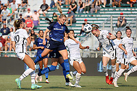 CARY, NC - SEPTEMBER 12: Becky Sauerbrunn #4 of the Portland Thorns FC wins a header against Amy Rodriguez #12 of the North Carolina Courage during a game between Portland Thorns FC and North Carolina Courage at Sahlen's Stadium at WakeMed Soccer Park on September 12, 2021 in Cary, North Carolina.