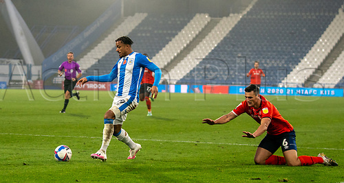 7th November 2020 The John Smiths Stadium, Huddersfield, Yorkshire, England; English Football League Championship Football, Huddersfield Town versus Luton Town; Josh Koroma of Huddersfield Town leaves Matty Pearson of Luton Town on the floor inside the penalty area