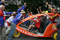 French National soccer team supporters playfully stop a pedi-taxi full of Spanish supporters from advancing outside the Hannover FIFA World Cup stadium before France and Spain's  second round FIFA World Cup match in Hannover, Germany  on Tuesday, June 27th 2006.  France defeated Spain 3-1.