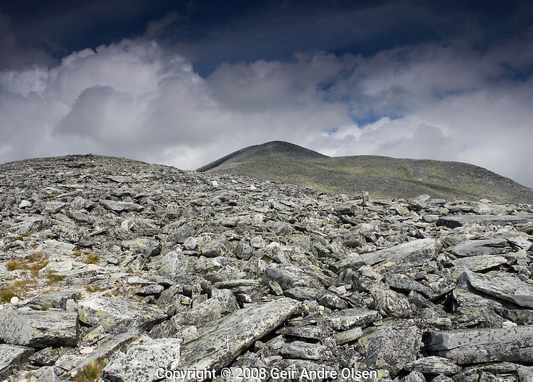 The last, rocky miles towards the peak of Storronden at Rondane National Park, Norway