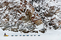 Hans Gatt runs on the Yukon River with the rocks at the Ruby checkpoint during the 2017 Iditarod on Thursday morning March 9, 2017.<br /> <br /> Photo by Jeff Schultz/SchultzPhoto.com  (C) 2017  ALL RIGHTS RESERVED