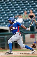 Travis Demeritte #22 of the AZL Rangers bats against the AZL Royals at Surprise Stadium on July 15, 2013 in Surprise, Arizona. AZL Rangers defeated the AZL Royals, 3-2. (Larry Goren/Four Seam Images)