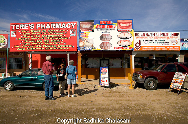 ALGODONES, MEXICO-MARCH 22: A tout tries to encourage an American couple to  visit his pharmacy March 22, 2005 in Algodones. Pharmaceuticals and medical care are one half to one third the cost in the U.S. Many on medicare in the U.S. do not have prescription drug plans.  ©Radhika Chalasani