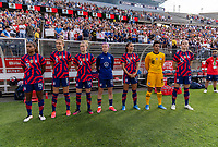 EAST HARTFORD, CT - JULY 5: Members of the USWNT stand during the anthem during a game between Mexico and USWNT at Rentschler Field on July 5, 2021 in East Hartford, Connecticut.