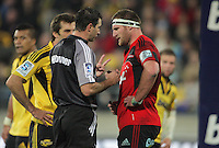 Referee Craig Joubert talks to Crusaders captain Kieran Read during the Super 15 rugby match between the Hurricanes and Crusaders at Westpac Stadium, Wellington, New Zealand on Saturday, 21 April 2012. Photo: Dave Lintott / lintottphoto.co.nz