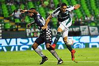PALMIRA - COLOMBIA - 14 - 02 - 2018: Pablo Sabaag (Der.) jugador de Deportivo Cali disputa el balón con Jose Luis Mosquera (Izq.) jugador de Boyaca Chico F. C., durante partido de la fecha 3 por la liga Aguila I 2018, jugado en el estadio Deportivo Cali (Palmaseca) en la ciudad de Palmira. / Pablo Sabaag (R) player of Deportivo Cali vies for the ball with Jose Luis Mosquera (L) player of Boyaca Chico F. C., during a match of the 3rd date for the Liga Aguila I 2018, at the Deportivo Cali (Palmaseca) stadium in Palmira city. Photo: VizzorImage / Luis Ramirez / Staff.