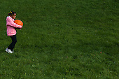 MR / Schenectady, NY. Girl (6, African-American) carries pumpkin outside. MR: Joh18. ID: AK-ICP. © Ellen B. Senisi