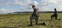 Members of the French Foreign Legion stand in position after jumping over the airport of Tarbes, France, during a full scale multi-force exercise, 11 December 2007.