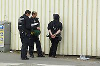 Gegen den Protest mehrerer tausend Menschen setzte die Polizei am 1. Mai in Berlin einen Aufmarsch von ca. 300 Neonazis aus ganz Deutschland durch. Es gab mehrere Versuche die Marschroute mit Blokaden zu sperren, so auch einer Betonpyramide, an die sich 4 Menschen angekettet hatten.<br />Im Bild: Eine verhaftete Gegendemonstrantin.<br />1.5.2013, Berlin<br />Copyright: Christian-Ditsch.de<br />[Inhaltsveraendernde Manipulation des Fotos nur nach ausdruecklicher Genehmigung des Fotografen. Vereinbarungen ueber Abtretung von Persoenlichkeitsrechten/Model Release der abgebildeten Person/Personen liegen nicht vor. NO MODEL RELEASE! Don't publish without copyright Christian-Ditsch.de, Veroeffentlichung nur mit Fotografennennung, sowie gegen Honorar, MwSt. und Beleg. Konto:, I N G - D i B a, IBAN DE58500105175400192269, BIC INGDDEFFXXX, Kontakt: post@christian-ditsch.de<br />Urhebervermerk wird gemaess Paragraph 13 UHG verlangt.]