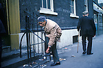 Brick Lane Mosque 1970s London UK Multi ethnic London. Muslim man removes his shoes before entering the Jamme Masjid Mosque.