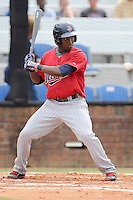 Right fielder Jeremias Pineda (5) of the Elizabethton Twins bats in a game against the Johnson City Cardinals on Sunday, July 27, 2014, at Howard Johnson Field at Cardinal Park in Johnson City, Tennessee. The game was suspended due to weather in the fifth inning. (Tom Priddy/Four Seam Images)