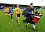 John Conlon of Clonlara leads out his team for the senior hurling county final at Cusack park. Photograph by John Kelly.