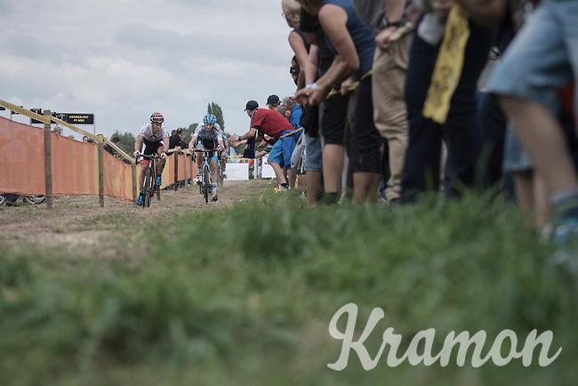 the very moment Michael Vanthourenhout (BEL/Marlux-NapoleonGames) takes control of the race and slips ahead of race leader Laurens Sweeck (BEL/Era-Murprotec) <br /> <br /> Brico-cross Geraardsbergen 2016<br /> U23 + Elite Mens race
