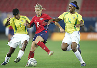 26 August 2004: Kristine Lilly battles for the ball against Formiga and Elaine of Brazil during the gold medal game at Karaiskakis Stadium in Athens, Greece.  USA defeated Brazil, 2-1 in overtime..