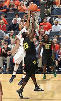 Dec. 17, 2010; Charlottesville, VA, USA; Oregon Ducks forward Jeremy Jacob (23) has his shot blocked by Virginia Cavaliers guard Mustapha Farrakhan (2) during the game at the John Paul Jones Arena. Virginia won 63-48. Mandatory Credit: Andrew Shurtleff-
