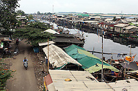 A view of one of Jakarta's rivers running through a slum community in the north of the city.<br /> <br /> To license this image, please contact the National Geographic Creative Collection:<br /> <br /> Image ID: 1588022 <br />  <br /> Email: natgeocreative@ngs.org<br /> <br /> Telephone: 202 857 7537 / Toll Free 800 434 2244<br /> <br /> National Geographic Creative<br /> 1145 17th St NW, Washington DC 20036