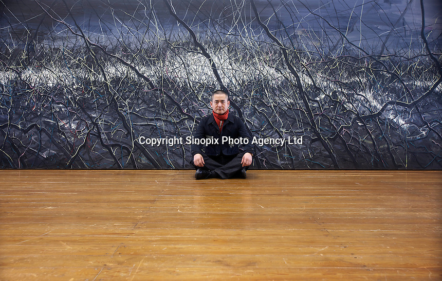 """Zeng Fanzhi, China's renowned contemporary artist, poses for pictures  in his Beijing studio on 9th November, 2012, China. Zeng gained the title of """"Number One"""" Chinese artist in terms of auction price in 2009.<br /> <br /> By Ricky Wong / Sinopix"""