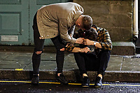 Pictured: A man sits on the pavement in Wind Street, Swansea, Wales, UK. Friday 20 December 2019<br /> Re: Black Eye Friday (also known as Black Friday, Mad Friday, Frantic Friday) the last Friday before Christmas, in Swansea, Wales, UK.