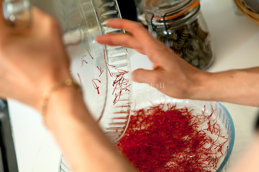 Freshly harvested saffron is transferred into a dish for oven-drying at La Ferme Lavancia, Puget-Théniers, France, 25 October 2013