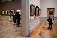 NEW YORK, NEW YORK - MARCH 19: People take a look of art works at The MET Museum on March 19, 2021 in New York. The Met Museum is considering selling some of its works to support itself after claming that the pandemic has caused a loss of revenue of $150 million in about 18 months. (Photo by John Smith/VIEWpress)