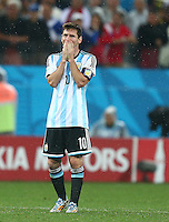 Lionel Messi of Argentina is overcome with emotion as he reacts during the penalty shoot out