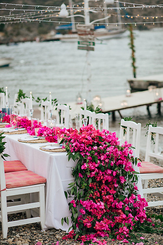 Wedding dinner table dressed for action ashore