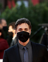 "Italian actor Raoul Bova wearing a face mask poses on the red carpet for the screening of the film ""Calabria, terra mia"" during the 15th Rome Film Festival (Festa del Cinema di Roma) at the Auditorium Parco della Musica in Rome on October 20, 2020.<br />