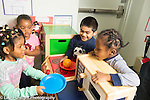 Preschool 3-4 year olds pretend play in kitchen area