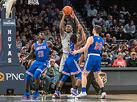 WASHINGTON, DC - DECEMBER 28: Qudus Wahab #34 of Georgetown wins the ball from Jamir Harris #4 of American. during a game between American University and Georgetown University at Capital One Arena on December 28, 2019 in Washington, DC.