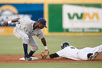 Shortstop Tim Beckham #22 of the Charlotte Stone Crabs puts the tag on Hunter Mense #4 of the Jupiter Hammerheads as he tries to steal second base at Roger Dean Stadium June 16, 2010, in Jupiter, Florida.  Photo by Brian Westerholt /  Seam Images