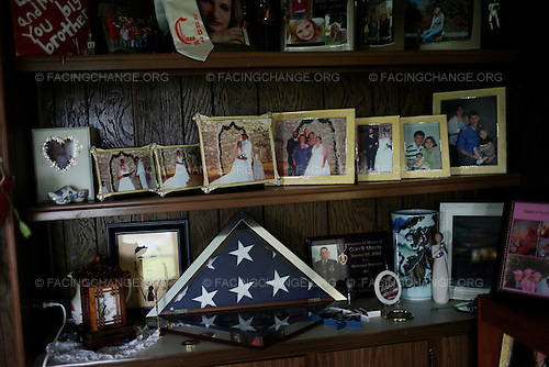 Hay Springs, Nebraska<br /> July 28, 2011<br /> <br /> A folded American flag, given to the Mracek family by the United States military for the death of their son in cmbat in Iraq, decorates the mantlepiece at their home in rural Hay Springs, Nebraska.