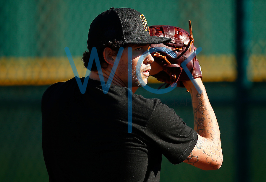 Steven Brault #65 of the Pittsburgh Pirates pitches in the bullpen during spring training at Pirate City in Bradenton, Florida on February 17, 2016. (Photo by Jared Wickerham / DKPS)